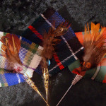 Feather and tartan brooch/hat pins